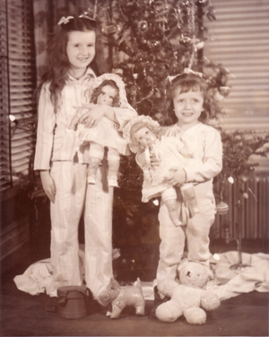 Marilyn and Mickey with dolls at Christmas